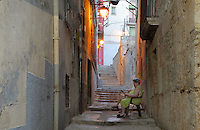 Old women sitting in the narrow stepped streets of the old town or Casc Antic of Tortosa, Tarragona, Spain. Tortosa is an ancient town situated on the Ebro Delta which has a rich heritage dating from Roman times. Picture by Manuel Cohen