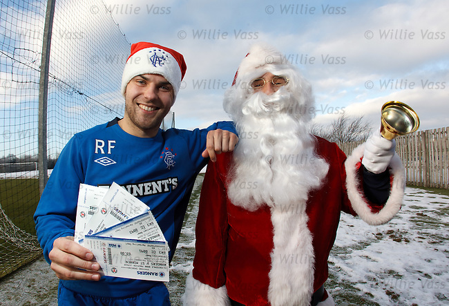 Richard Foster with Santa at Murray Pak as Rangers promote kids ticket prices for the St Miren game