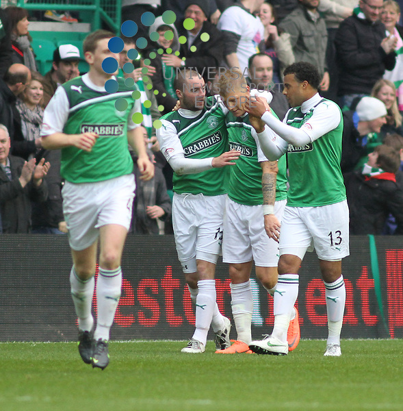 Garry O'Connor is mobbed by team mates after making it 3-0 Hibs. Monday 7th May 2012, Hibernian host Dunfermline at Easter Road, needing only a point to secure their place in the SPL and consign Dunfermline to relegation. Universal News And Sport (Europe) All pictures must be credited to www.unpixs.com. (Office)0844 884 51 22.