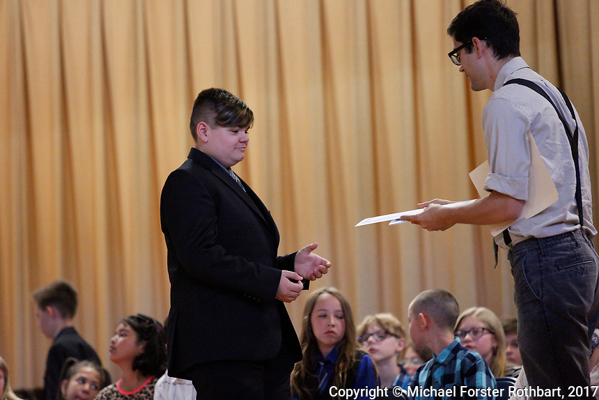 The Oneonta Greater Plains elementary school fifth grade awards ceremony, on June 21, 2017.<br /> &copy; Michael Forster Rothbart Photography<br /> www.mfrphoto.org &bull; 607-267-4893<br /> 34 Spruce St, Oneonta, NY 13820<br /> 86 Three Mile Pond Rd, Vassalboro, ME 04989<br /> info@mfrphoto.org<br /> Photo by: Michael Forster Rothbart<br /> Date:  6/21/2017<br /> File#:  Canon &mdash; Canon EOS 5D Mark III digital camera frame C19295