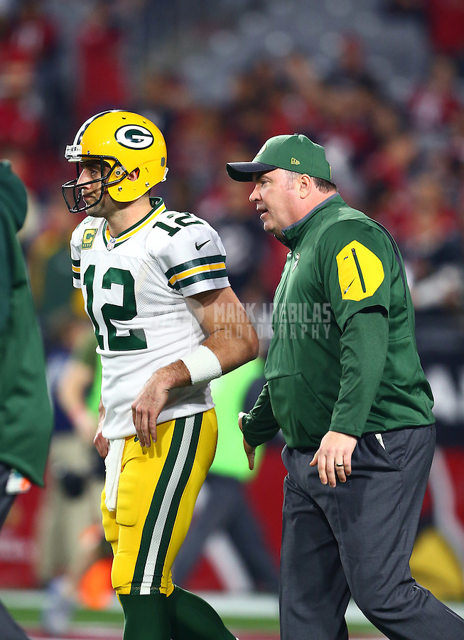 Jan 16, 2016; Glendale, AZ, USA; Green Bay Packers quarterback Aaron Rodgers (12) and head coach Mike McCarthy against the Arizona Cardinals in the first quarter of a NFC Divisional round playoff game at University of Phoenix Stadium. Mandatory Credit: Mark J. Rebilas-USA TODAY Sports
