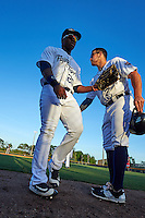 Lakeland Flying Tigers left fielder Christin Stewart (20) greeted by Ross Kivett (7) after a half inning during a game against the Tampa Yankees on April 7, 2016 at Henley Field in Lakeland, Florida.  Tampa defeated Lakeland 9-2.  (Mike Janes/Four Seam Images)