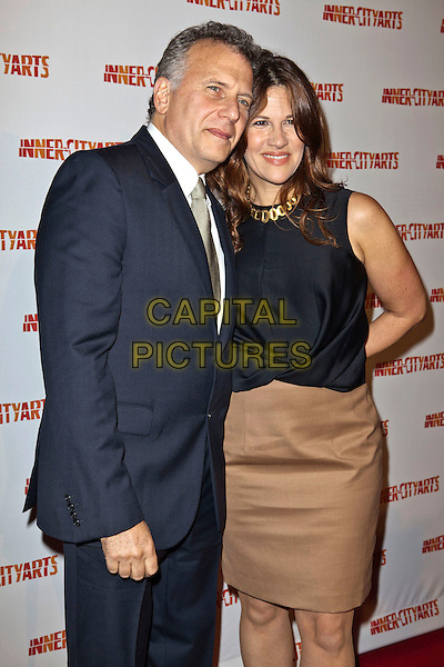 Paul & Paula Reiser.2011 Imagine Awards Gala Hosted by Inner-Ciity Arts held at The Beverly Hilton,Beverly Hills, California, USA..27th October 2011 .half length black top beige skirt married husband wife suit jacket gold tie white shirt .CAP/ADM/ES.©Emiley Schweich/AdMedia/Capital Pictures.