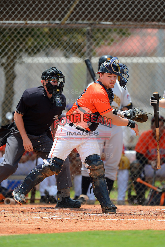 GCL Astros catcher Brett Booth (13) throws down to first in front of umpire Russ Weich during a game against the GCL Pirates on July 16, 2013 at Osceola County Complex in Kissimmee, Florida.  GCL Pirates defeated the GCL Astros 6-3.  (Mike Janes/Four Seam Images)