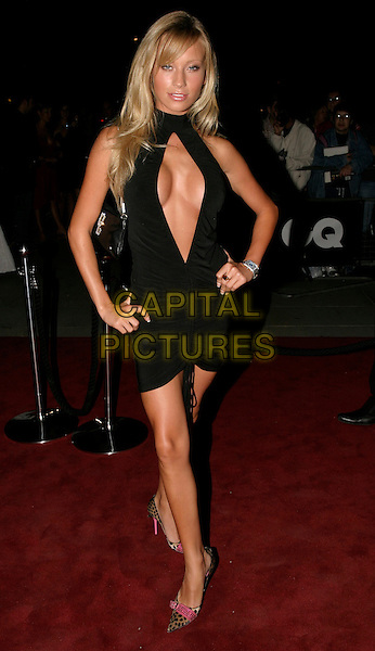 NATALIE DENNING.The 8th Anual GQ Men of The Year Awards,.The Royal Opera House,.London, 6th September 2005.full length black halter neck open front cleavage dress hand hip animal print pink shoes.www.capitalpictures.com.sales@capitalpictures.com.© Capital Pictures.