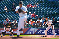Gavin Sheets (24) of the Wake Forest Demon Deacons holds Christopher Barr (17) of the Miami Hurricanes on first base as starting pitcher Parker Dunshee (36) delivers a pitch to the plate during Game Nine of the 2017 ACC Baseball Championship at Louisville Slugger Field on May 26, 2017 in Louisville, Kentucky. The Hurricanes defeated the Demon Deacons 5-2. (Brian Westerholt/Four Seam Images)