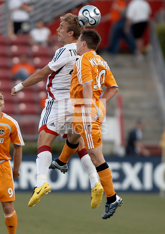 New England Revolution forward Taylor Twellman (20) and Houston Dynamo defender Richard Mulrooney (30) go for the header.  New England Revolution beat Houston Dynamo 1-0 at Robertson Stadium in Houston, TX on May 19, 2007.