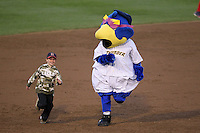 Trenton Thunder mascot Boomer and a fan do the base race during a game against the Portland Sea Dogs at Waterfront Park on May 4, 2011 in Trenton, New Jersey.  Trenton defeated Portland by the score of 7-1.  Photo By Mike Janes/Four Seam Images