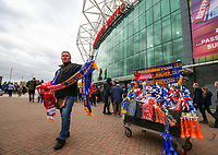 A scarf seller works outside Old Trafford, before the Super League Grand Final between Wigan Warriors and Warrington Wolves<br /> <br /> Photographer Alex Dodd/CameraSport<br /> <br /> Betfred Super League Grand Final - Wigan Warriors v Warrington Wolves - Saturday 13th October 2018 - Old Trafford - Manchester<br /> <br /> World Copyright &copy; 2018 CameraSport. All rights reserved. 43 Linden Ave. Countesthorpe. Leicester. England. LE8 5PG - Tel: +44 (0) 116 277 4147 - admin@camerasport.com - www.camerasport.com