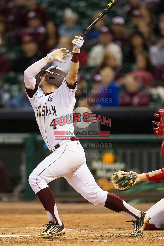 Texas A&M Aggie second baseman Charlie Curl #4 follows through on his swing against the Houston Cougars in the NCAA baseball game on March 1st, 2013 at Minute Maid Park in Houston, Texas. Houston defeated Texas A&M 7-6. (Andrew Woolley/Four Seam Images).