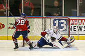 March 15, 2009:  Goalie Cedrick Desjardins (30) of the Hamilton Bulldgos, AHL affiliate of Montreal Canadians, makes a save on Judd Blackwater (28) during the overtime shoot out of a regular season game at the Blue Cross Arena in Rochester, NY.  Hamilton defeated Rochester 4-3 in a shoot out.  Photo Copyright Mike Janes Photography 2009