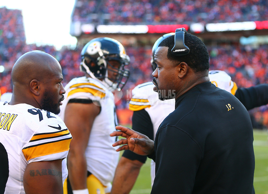 Jan 17, 2016; Denver, CO, USA; Pittsburgh Steelers outside linebackers coach Joey Porter (right) talks to linebacker James Harrison (92) against the Denver Broncos during the AFC Divisional round playoff game at Sports Authority Field at Mile High. Mandatory Credit: Mark J. Rebilas-USA TODAY Sports