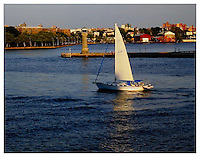 YORKVILLE, NY - AUGUST 8: Photograph of sailboat passing Roosevelt Island Lighthouse on the East River from Carl Schurz Park taken in Yorkville, New York on August 8, 2012. Photo Credit: Thomas R. Pryor