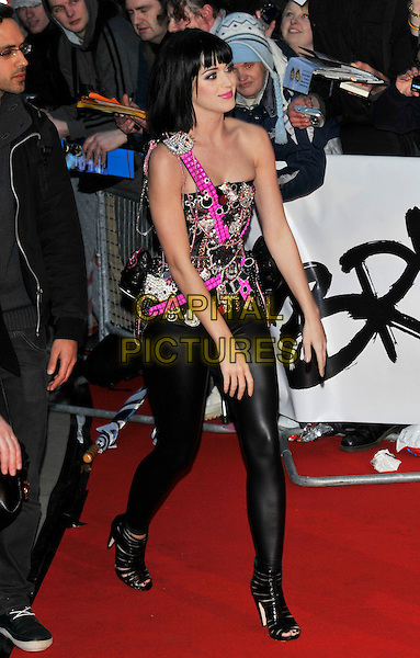 KATY PERRY .Arrivals - 2009 Brit Awards, Earls Court, London, England, February 18th 2009..brits full length black and pink Hello Kitty embellished bustier corset top leggings wet look shiny diamante Dolce Vita strappy shoes booties open toe walking.CAP/PL.©Phil Loftus/Capital Pictures