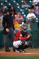 Umpire Ian Fazio and Buffalo Bisons catcher George Kottaras (17) during a game against the Pawtucket Red Sox  on August 28, 2015 at Coca-Cola Field in Buffalo, New York.  Pawtucket defeated Buffalo 7-6.  (Mike Janes/Four Seam Images)