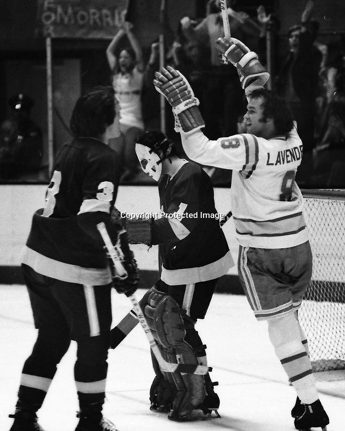 Seals Brian Lavender scores against the Los Angeles Kings goalie Gary Edwards, and #3Larry Brown.<br />(1975 photo by Ron Riesterer)