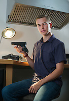 Founder of Biofire Technologies Kai Kloepfer at his home workshop in Boulder, Colorado, Tuesday, August 23, 2016. Kloepfer has invented the first ever smart handgun which requires a fingerprint match to fire the gun. <br /> <br /> Photo by Matt Nager
