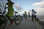 Belize - SEPTEMBER 14, 2007: Two girls and a boy ride their bike along the waterfront in Punta Gorda on September 14, 2007 in Belize.  (PHOTOGRAPH BY MICHAEL NAGLE)