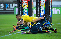 Hurricanes' Ngani Laumape scores his first try in the tackle of Highlanders' Ben Smith during the Super Rugby match between the Hurricanes and Highlanders at Westpac Stadium in Wellington, New Zealand on Friday, 1 March 2019. Photo: Dave Lintott / lintottphoto.co.nz