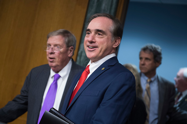 UNITED STATES - FEBRUARY 01: David Shulkin, nominee for Veterans Affairs secretary, arrives for his Senate Veterans' Affairs Committee confirmation hearing in Dirksen Building, February 1, 2017. Chairman Johnny Isakson, R-Ga., appears at left. (Photo By Tom Williams/CQ Roll Call)