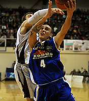 Lindsay Tait is fouled by Hawks guards Aiden Daly. NBL - Wellington Saints v Bay Hawks at TSB Bank Arena, Wellington, New Zealand on Friday, 3 June 2011. Photo: Dave Lintott / lintottphoto.co.nz