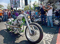 NWA Democrat-Gazette/BEN GOFF @NWABENGOFF<br /> Laramie LaFarge, master of ceremonies from Miami, Okla.,  interviews Mike McLaughlin of Oklahoma City, Okla. about his Radical Custom bike made by Darwin Motorcycles in Oklahoma City on Saturday Sept. 26, 2015 during the Stokes Air Battle of the Bikes at the annual Bikes, Blues & BBQ motorcycle rally in downtown Fayetteville.