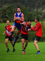 Peter Halstead takes a high ball during the Wellington Australian Rules Football club final match between the Bulldogs and North City Demons at Hutt Park, Wellington, New Zealand on Saturday, 22 November 2014. Photo: Dave Lintott / lintottphoto.co.nz
