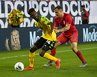NASHVILLE, TN - JULY 3: Shaun Francis #14 and Jordan Morris #11 contest the ball during a game between Jamaica and USMNT at Nissan Stadium on July 3, 2019 in Nashville, Tennessee.