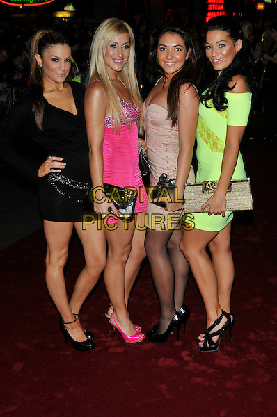 "CANDY ROCK - Tita, Emily & Katerina & Sophia.Attending the UK film premiere of ""The Imaginarium Of Doctor Parnassus"" at the Empire Leicester Square cinema, London, England, UK, October 6th 2009..full length girl band group black pink dress yellow green neon shoes clutch bag strapless beige clutch bag .CAP/PL.©Phil Loftus/Capital Pictures."