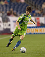 Seattle Sounders FC midfielder Alvaro Fernandez (15) crosses the ball. The New England Revolution defeated the Seattle Sounders FC, 3-1, at Gillette Stadium on September 4, 2010.