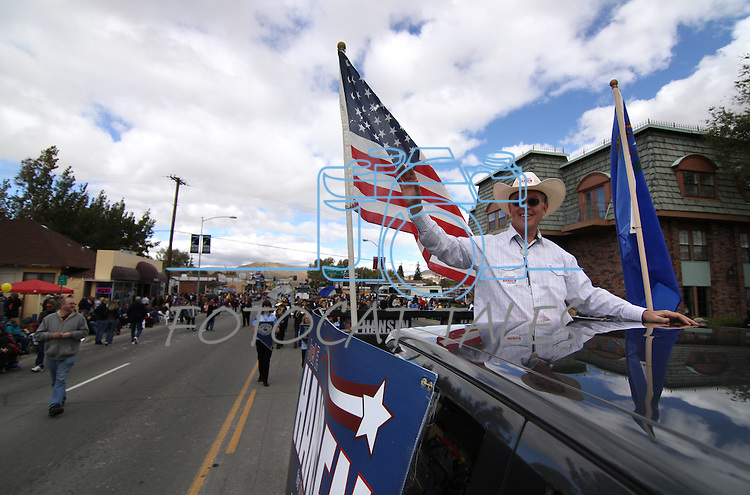 Joel Hansen, Independent Party candidate for Attorney General, waves at the crowd during the Nevada Day parade on Saturday, Oct. 30, 2010, in Carson City, Nev. .Photo by Cathleen Allison