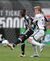 DC United midfielder Freddy Adu (9) traps the ball and is defended by Colorado Rapids midfielder Jacob Peterson (15) during the game. DC United tied the Coloradio Rapids 1-1, Saturday, August 19, 2006 at RFK Stadium.