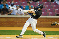 Conor Keniry #14 of the Wake Forest Demon Deacons strokes an RBI single in the bottom of the 5th inning against the Florida State Seminoles at Wake Forest Baseball Park on March 23, 2012 in Winston-Salem, North Carolina.  (Brian Westerholt/Four Seam Images)
