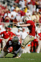 TALLAHASSEE, FL 10/31/09-FSU-NCST FB09 CH50-Florida State's Dustin Hopkins makes a point after touchdown kick against N.C. State during second half action Saturday at Doak Campbell Stadium in Tallahassee. The Seminoles beat the Wolf Pack 45-42..COLIN HACKLEY PHOTO