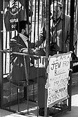 "Unidentified Jewish protestor sits in a mock jail on the sidewalk outside the White House in Washington, DC to protest the treatment of Soviet Jews in Russia on March 21, 1971.  More than 680 people were arrested.  After the sit-in members of the Jewish Defense League (JDL) moved to the Elllipse for speches and told the demonstrators ""President Nixon will have to change his policy if enough Jews show themselves willing to sacrifice.""<br /> Credit: Len Owens / CNP"