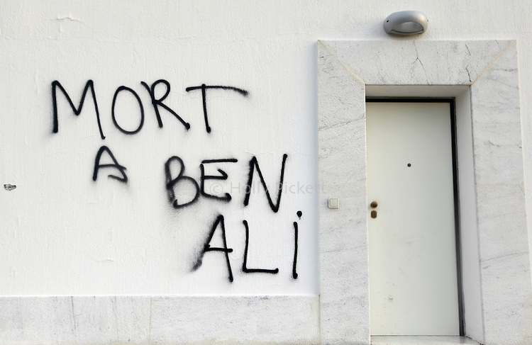 Graffiti painted outside the home of a relative of Tunisian President Zine el-Abidine Ben Ali, calls for the president's death, in Hammamet, Tunisia, about an hour's drive from the capital of Tunis, Thursday, Jan. 13, 2011. Tunisia has been rocked by violent protests which began nearly one month ago.