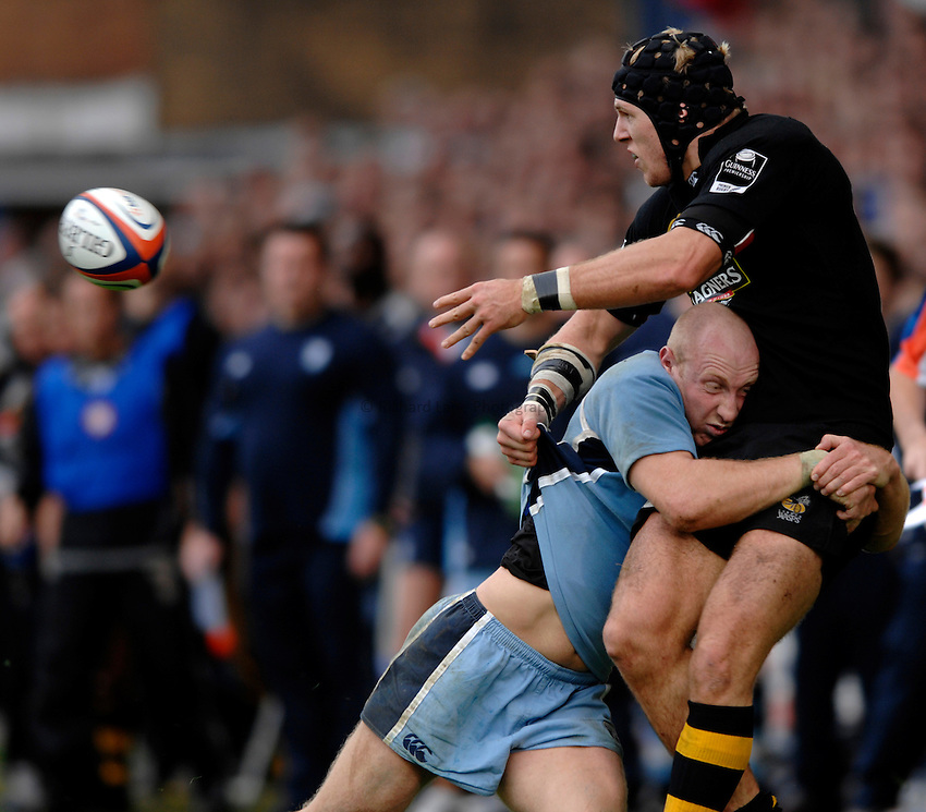 Photo: Richard Lane..Cardiff Blues v London Wasps. EDF Anglo-Welsh Cup. 30/09/2006. .Wasps' James Haskell passes as he is tackled by Tom Shanklin.