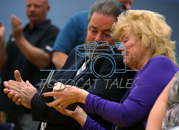 Peggy Eddington-Smith shows her husband Kevin Smith her father's purple heart medal during a ceremony, in Dayton, Nev., on Saturday, Sept. 20, 2013. After 14 years of searching for relatives of World War II Private John F. Eddington, the medal and other personal items, found in Missouri, were returned to Eddington-Smith. <br /> Photo by Cathleen Allison/Las Vegas Review-Journal
