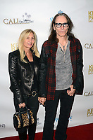 HOLLYWOOD, CA - NOVEMBER 8: Pia Maiocco, Steve Vai at the Pop-Up Art Show by Billy Morrison and Steve Stevens at Ken Paves Salon in West Hollywood, California on November 8, 2019. Credit: David Edwards/MediaPunch