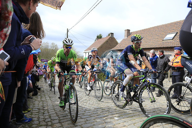 The peleton, including Bram Tankink (NED) Belkin, climb the Molenberg during the 2014 Tour of Flanders, Belgium.<br /> Picture: Eoin Clarke www.newsfile.ie