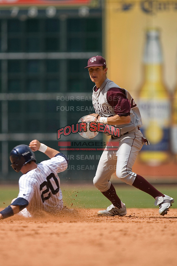 Shortstop Adam Smith #20 gets the out at second base versus the UC-Irvine Anteaters in the 2009 Houston College Classic at Minute Maid Park February 27, 2009 in Houston, TX.  The Aggies defeated the Anteaters 9-2. (Photo by Brian Westerholt / Four Seam Images)