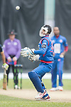 Shahid Wasif of Kowloon Cantons (R) jumps to catch off the ball during the Hong Kong T20 Blitz match between Galaxy Gladiators Lantau and Kowloon at Tin Kwong Road Recreation Ground on March 11, 2017 in Hong Kong, Hong Kong. Photo by Chris Wong / Power Sport Images