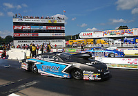 Aug 15, 2014; Brainerd, MN, USA; NHRA pro stock driver Jonathan Gray (near lane) races alongside Larry Morgan during qualifying for the Lucas Oil Nationals at Brainerd International Raceway. Mandatory Credit: Mark J. Rebilas-