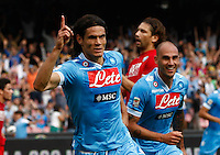 Napoli's  forward Edinson Cavani i celebrates after  scores against the Siena  during their Italian Serie A soccer match   at the San Paolo stadium in Naples.
