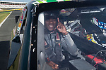 Ja'Cquez Williams of the Wake Forest Demon Deacons is ready for his ride-along in a NASCAR race car as part of the 2017 Belk Bowl festivities at the Charlotte Motor Speedway on December 26, 2017 in Concord, North Carolina.  (Brian Westerholt/Sports On Film)