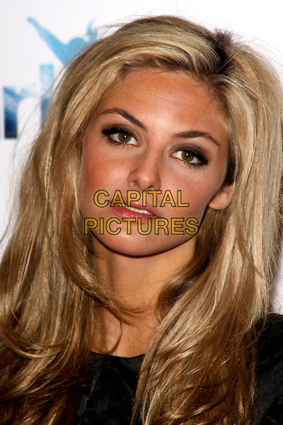 TAMSIN EGERTON.'Chalet Girl' world film premiere at Vue Westfield cinema, Shepherd's Bush, London, England 8th February 2011..headshot portrait curly wavy hair black  make-up tan tanned .CAP/AH.©Adam Houghton/Capital Pictures.