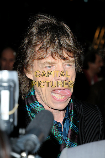 "THE ROLLING STONES - MICK JAGGER.UK premiere of ""Shine A Light"" Odeon Cinema, Leicester Square, London, England..April 2nd, 2008.headshot portrait mouth open tongue funny face .CAP/CAN.©Can Nguyen/Capital Pictures."
