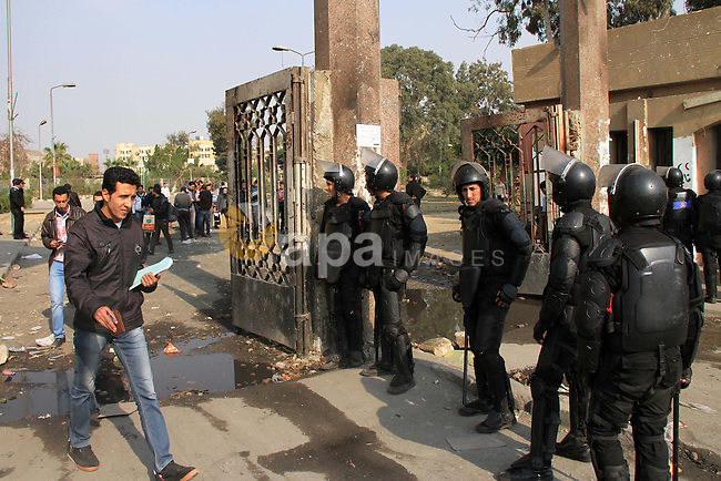 Egyptian security forces check students of al-Azhar University outside their residential area, in Cairo, January 12, 2013. Reports state that three years after the Arab Spring, pro-military groups and old regime stalwarts are working together to back Egypt's draft constitution in a referendum, which they hope will lend legitimacy to last year's ouster of Islamist president Mohammed Morsi. The vote, set to take place on 14 and 15 January 2014, comes against the backdrop of weeks of violent clashes, which the military-backed government has blamed on Morsi's now-outlawed Muslim Brotherhood. Photo by Mohammed Bendari