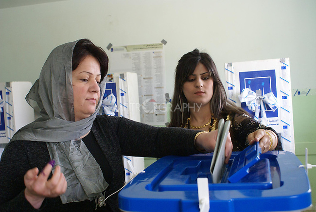 HALABJA, IRAQ: A woman casts her ballot in Halabja...On March 7th, 2010, Iraq held nationwide parliamentary elections.