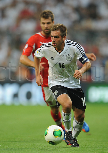 06.09.2013. Allianz Arena, Munich, Germany.  Germany's Philipp Lahm (front) and Andreas Ivanschitz of Austria vie for the ball during the FIFA World Cup 2014 qualification group C soccer match between Germany and Austria .